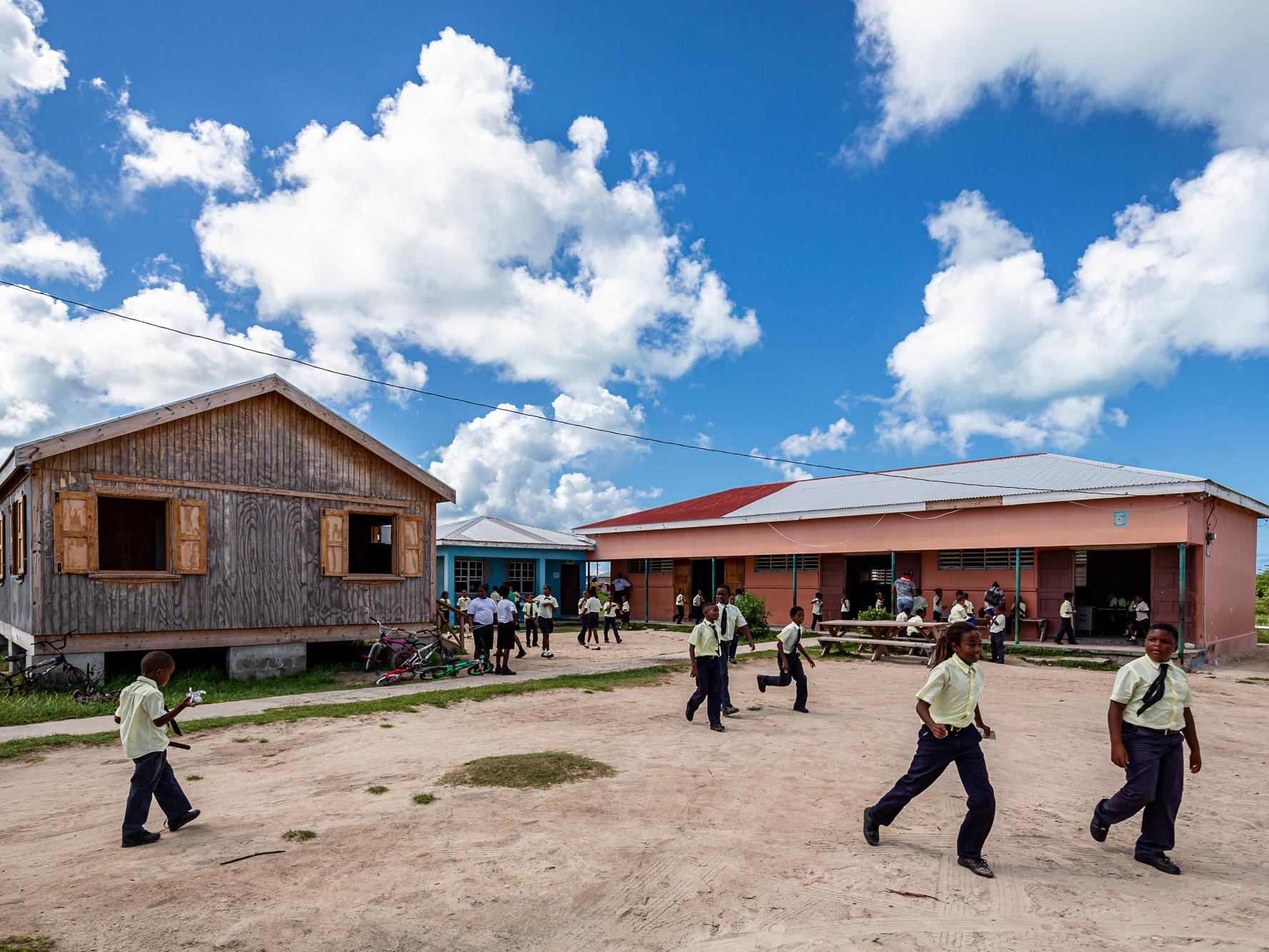 Children run in the courtyard outside Barbuda Primary School