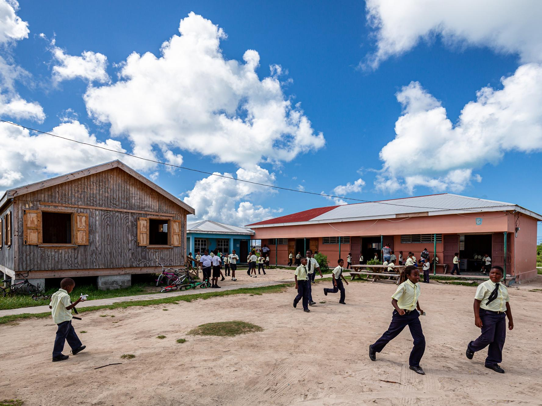 Children playing outside a resilient primary school in Barbuda