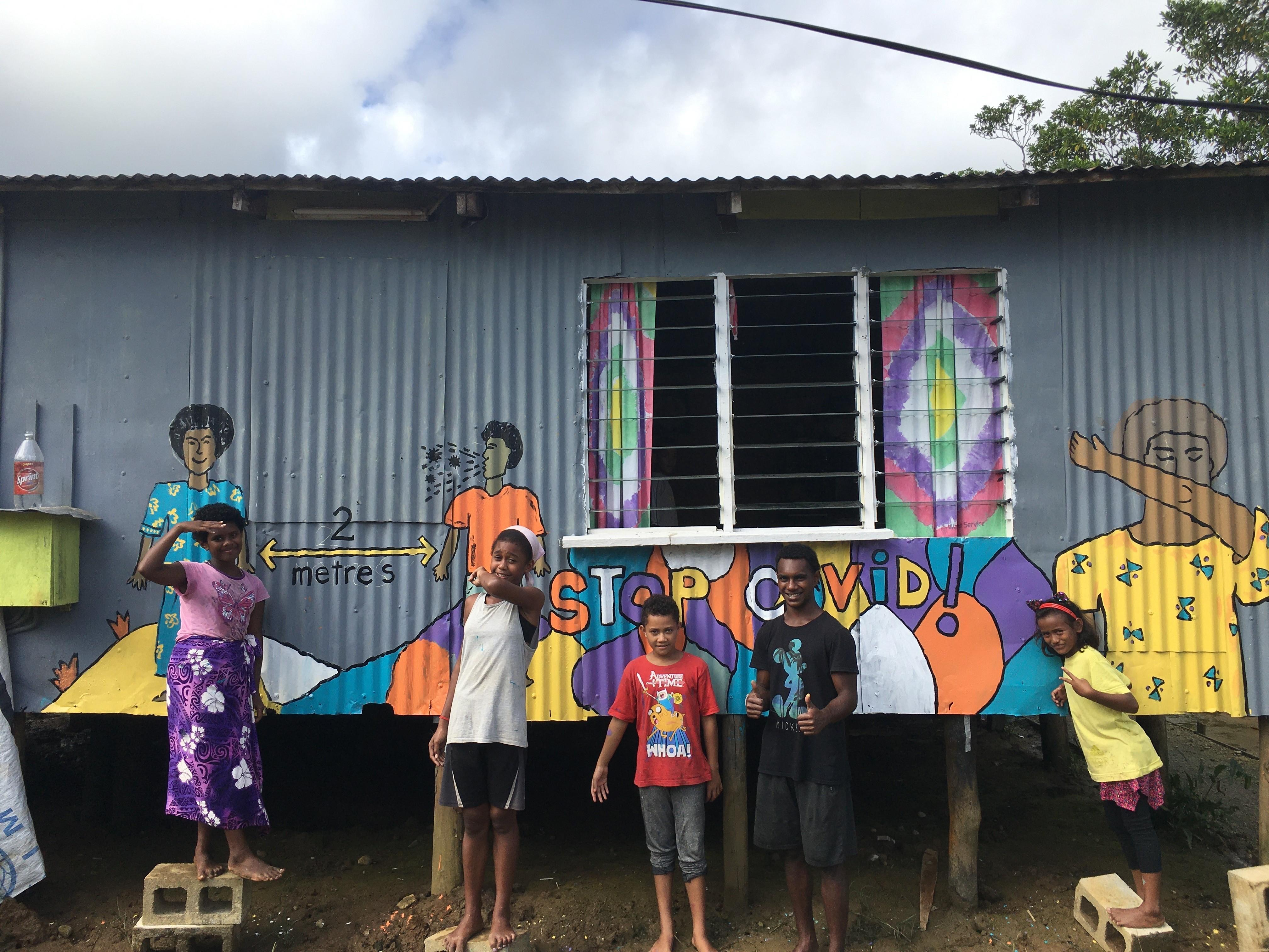 Youth and a COVID-19 awareness mural, Fiji