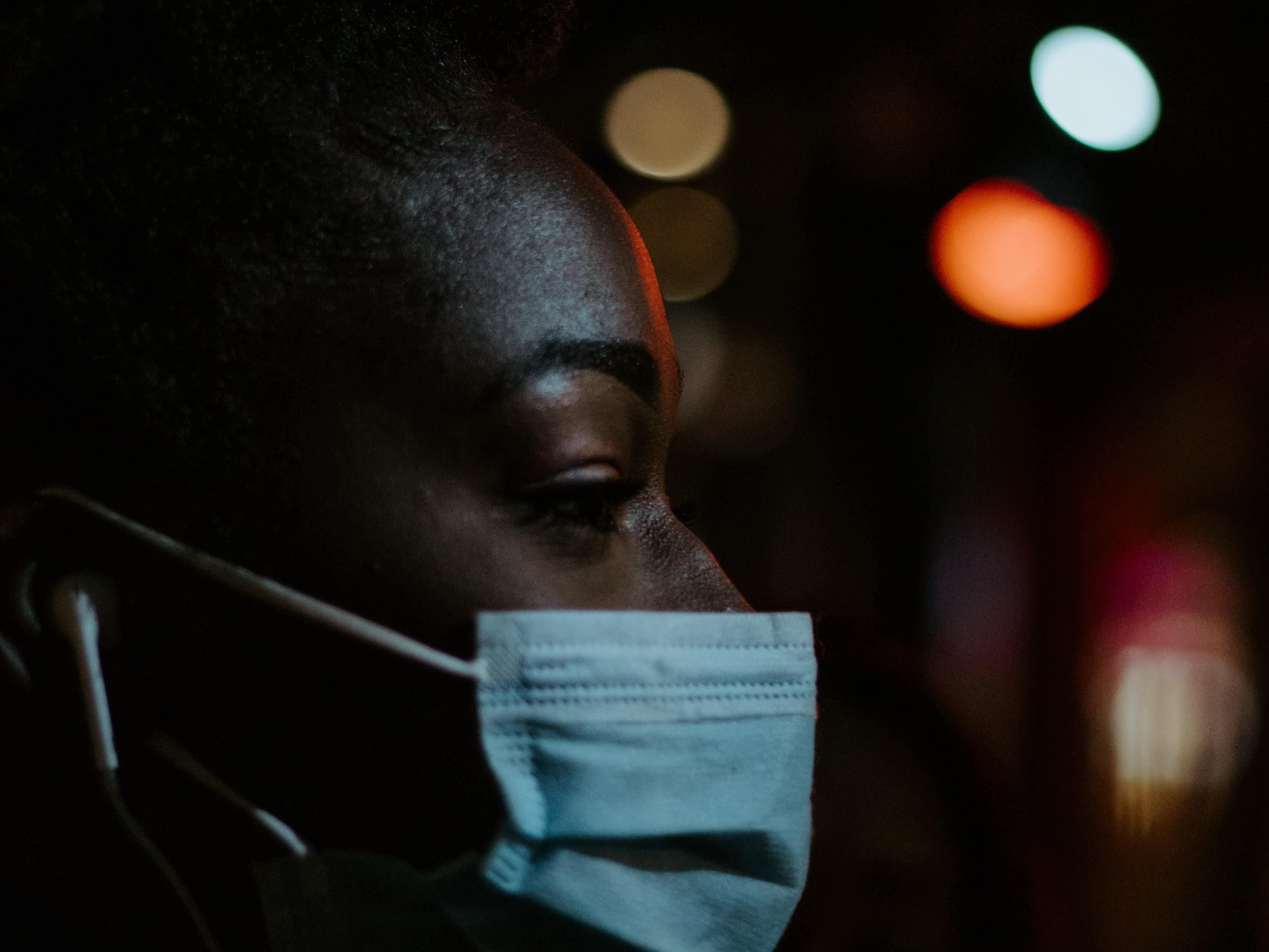 Image of woman wearing a surgical mask