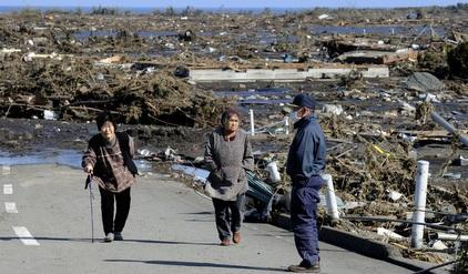 Elderly people look at the extensive damages from the tsunami in Minamisoma, Fukushima Prefecture on March 12, 2011 (Photo: TORU YAMANAKA/AFP/Getty Images)