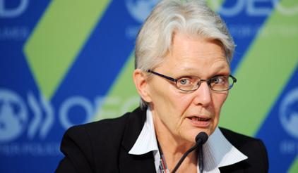 UNISDR Chief Margareta Wahlstrom speaking to the press at the launch of a new OECD report on disaster losses. (Photo: OECD)