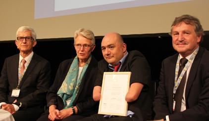 At the 2014 Risk Award ceremony in Davos (from left):  Walter J. Amman, Global Risk Forum; Margareta Wahlstrom, UNISDR; award winner Carlos Kaiser, Inclusiva NGO;  and Thomas Loster, MunichRe Foundation. (Photo: UNISDR)
