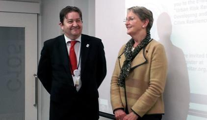 Mr McFarlane (left) with Ms Fegan-Wyles at the official launch of the new E-learning course. (Photo: UNISDR)