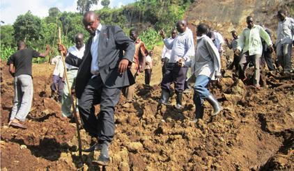 Local government officials inspect the scene of a 2013 landslide disaster in Uganda. (Photo: Denis Olaka/Uganda)