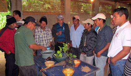 A gathering at the seek bank in El Solis, Guatemala. The community deploys local knowledge of biodiversity to reduce disaster risk and supports International Day for Disaster Reduction. (Photo: UNISDR)