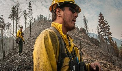Trainee Bobby Robedeaux, of a fire fighting squad of the Pawnee, Ponca and Otoe tribes, traverses a burned out hillside, looking for hotspots, in Hailey, Idaho, in 2013. (Photo: USDA/Lance Cheung)