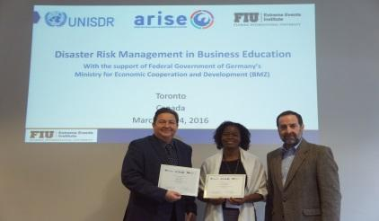 Ms. Indianna D. Minto-Coy (centre) from the Mona School of Business & Management, University of the West Indies, winner of the award for best disaster risk management new academic offering, is congratulated by Professor Juan Pablo Sarmiento of Florida International University (right) and Mr. Neil McFarlane of UNISDR (left) (Photo: UNISDR)