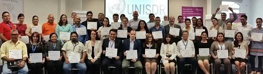 Participants display their certificates as trainers in disaster risk reduction planning (Photo: UNISDR)