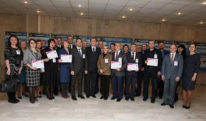 Representatives of the six Russian municipalities that have joined the Making Cities Resilient campaign display the certificates that they received at the event in Moscow (Photo: EMERCOM)
