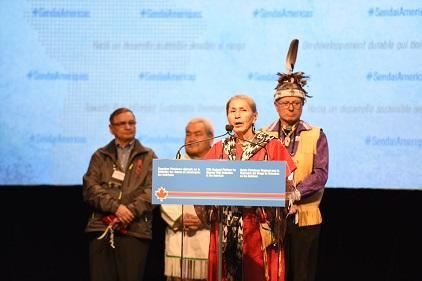 Algonquin Nation Elder Ms. Rose Wawatie (front) leads the opening ceremony for the 5th Regional Platform for Disaster Risk Reduction in the Americas, flanked by (from left) Métis Elder Mr. Jim Durocher, Inuit Elder Mr. David Serkoak, and Mohawk Nation Elder Mr. Kevin Ka'nahsohon Deer (Photo: Public Safety Canada/UNISDR)