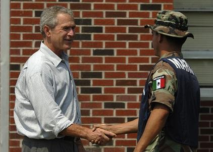 President George Bush thanks a Mexican army officer taking part in the Hurricane Katrina relief effort in 2005