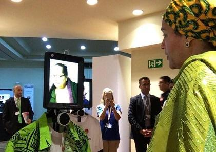 UN Deputy Secretary-General Amina Mohammed interacts with Lanieta Tuimabu, a board member of the Pacific Disability Forum, thousands of kilometres away thanks to the telepresence robot. (Photo: Catherine Naughton)