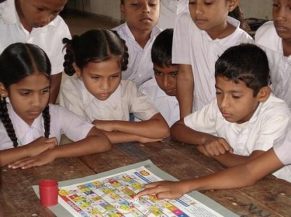 Children playing 'Riskland,' a game which creates awareness about natural hazards and how to prepare.  Photo credit: UNDP Sri Lanka