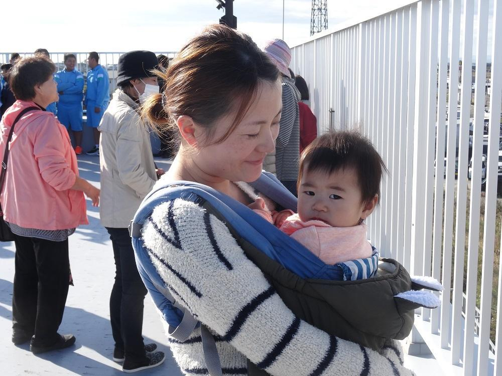Mother and child safe on the top of a Sendai tsunami evacuation tower in today's evacuation exercise