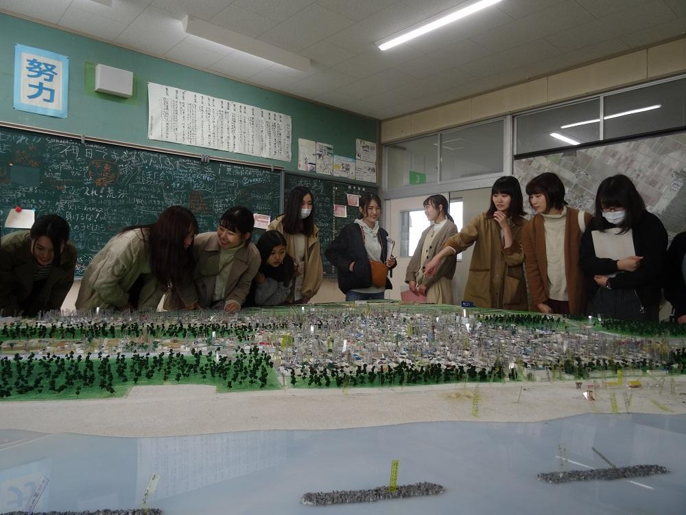 Student teachers visiting the exhibition space at Arahama Elementary School in Sendai, Japan, for World Tsunami Awareness Day